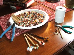 Old necklaces repurposed to English bobbins