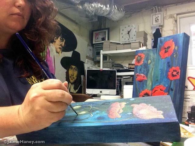 artist Jaime Haney painting in art studio